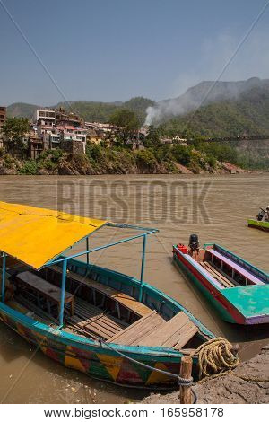 RISHIKESH, INDIA. 9 June 2009: Boats on the banks of the river Ganges. Rishikesh, India.
