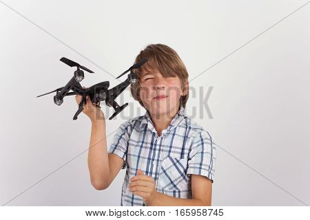 A Young boy playing with hist drone