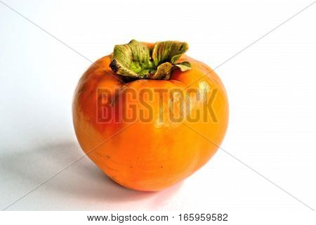 Closeup of a persimmon on a white background