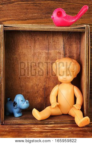 The vintage soviet doll and other old toys in the wooden box. Mass production in USSR 1970 - 1980