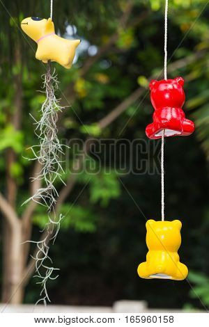 Colorful ceramic mobiles in animal shape used for garden decoration and also for planting the Spanish moss