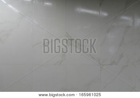 Textural background of gray stone wall tiles.
