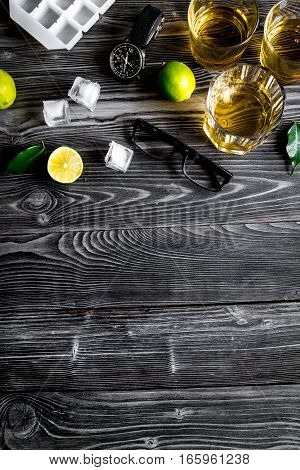 glass of scotch on dark wooden background top view.