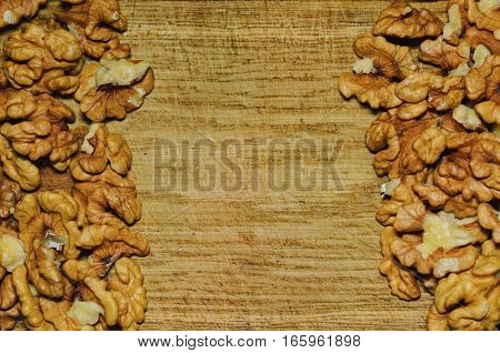 Top view of walnuts on natural wooden background frame composition