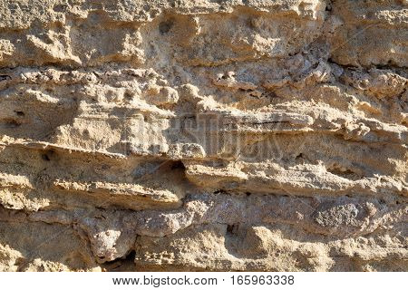 Texture background of sandstone in sunlight natural