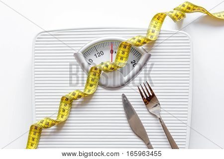 floor scale and apple on white background top view.