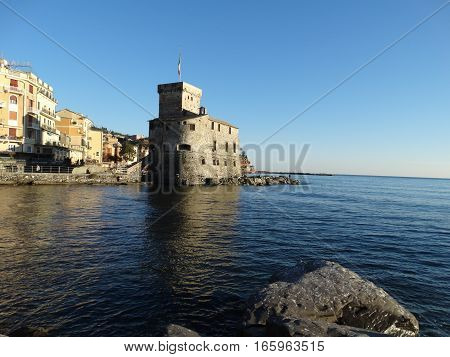 A shot of a castler on the coast of the sea in a tipical italian city in winter.