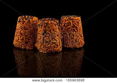 sweet cake anthill on a black background with reflection