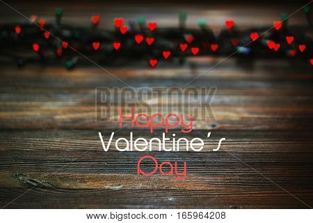 red heart bokeh, Valentine's day concept on wooden background, greeting card