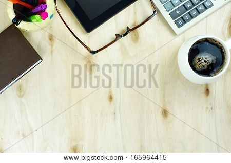 Cup of Coffee and Finance Office supply on table desk in top view.