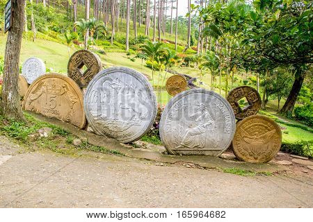 Installation with coins of different countries model in a park Prenn, Dalat city Vietnam, October 2016