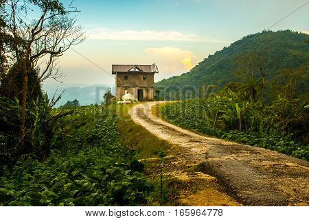 CAMERON HIGLANDS, MALAYSIA, JULY 28th 2015: Forgotten house at the end of the road in the cameron highlands in Malaysia warm afternoon light