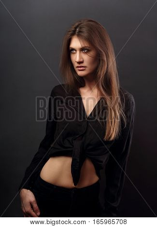 Grace Sexy Female Model Posing In Black Shirt With Long Hair Style On Dark Background