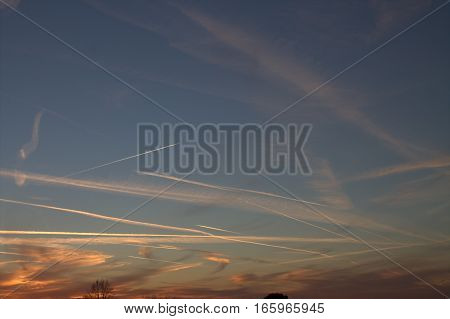 contrails in the sky in the evening sky sunset