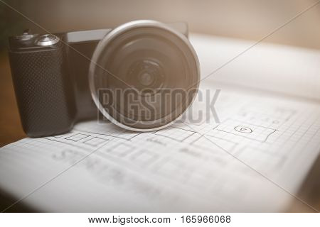 Digital Camera On Notepad With Storyboard