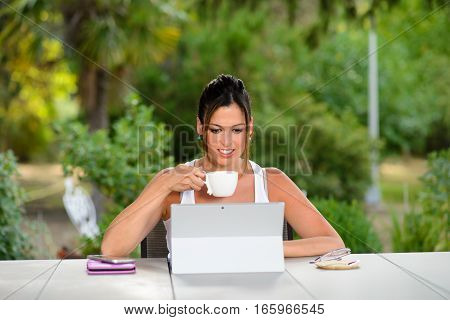Professional Casual Woman Working Online With Laptop Outside