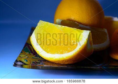 slices of orange on a blue background
