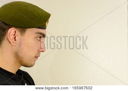young soldier in a green beret intelligence