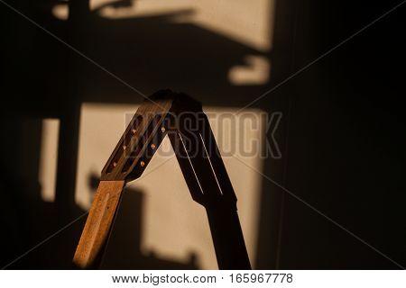 unfinished vulture guitar in sunlight at workshop.