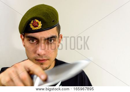 military green beret with a knife intelligence