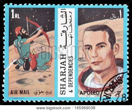 SHARJAH - CIRCA 1972 : Cancelled postage stamp printed by Sharjah, that shows Apollo crew.