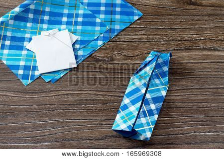 Gift For Father's Day. The Child Makes A Gift Of Origami Paper Shirt. Made By Hand. Children's Art P