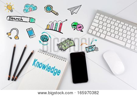 Knowledge. Office desk table with computer, Smartphone