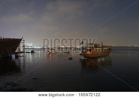 Night scene ships and lights in Dubai harbour