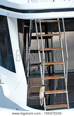 A macro shot of a boat ladder going up atop the vessel