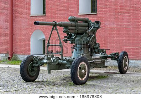 Anti-aircraft artillery gun on a wheeled platform standing in the courtyard of the Peter and Paul fortress in Saint-Petersburg.