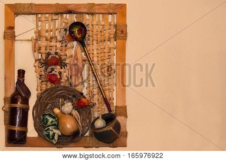 Still life in a wooden frame with a lattice on a background of beige wall.