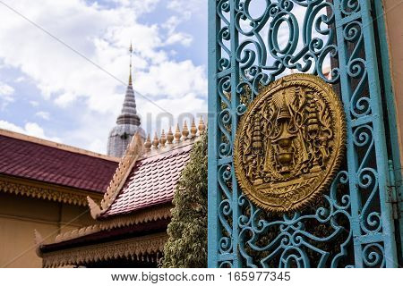 Carved bas-relief on a gate of asian thai temple for decoration .