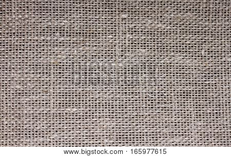 the background of coarse linen with a texture of threads and weaves