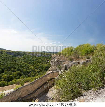 The mountainous landscape and the ruins of the city-fortress Chufut-Kale. Crimea Russia