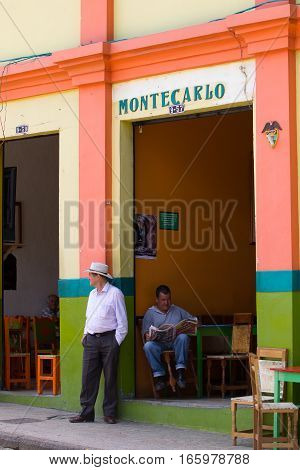 September 30 2016 El Jardin Colombia: locals relaxing in a coffee shop in the center of the tourist town