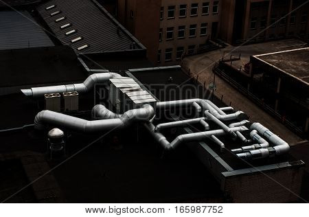 View of air conditioning ducts and ventilation tubes on the roof .