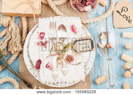 Tableware And Silverware With Different Decorations On The Table