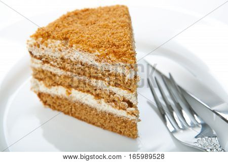 one piece of cream cake on the plate and fork