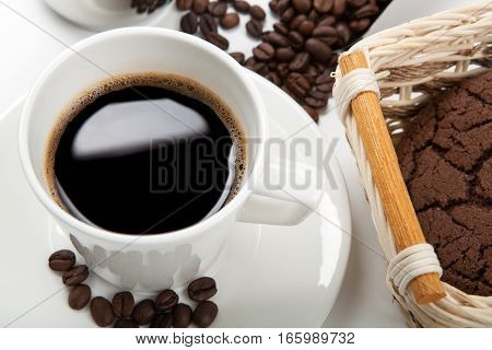 cup of coffee and beans and chocolate cookies