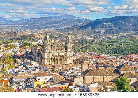 Aerial cityscape of Jaen with cathedral and Sierra Magina mountains on background Andalusia Spain