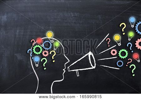 Share your knowledge concept with human head shape on blackboard