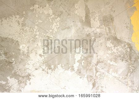 Wall in gray stucco inside house in process of repair as background closeup
