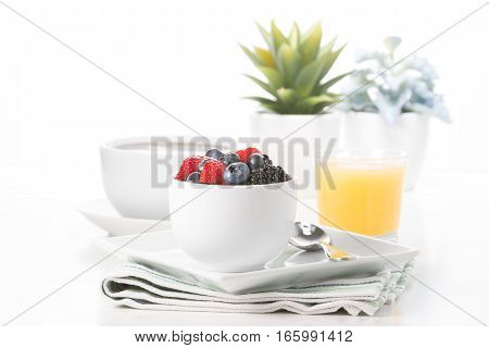 Small bowl of fresh berries served with coffee and juice.