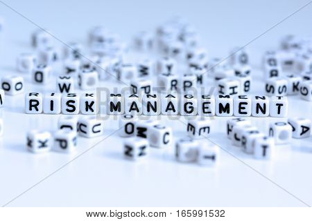 Risk management text from white tiled letters