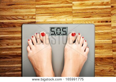 Diet problems concept with weight scale spelling SOS