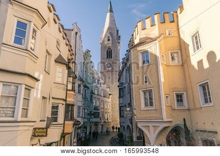 Brixen Italy - December 26 2016: Brixen downtown with old buildings and White Tower.