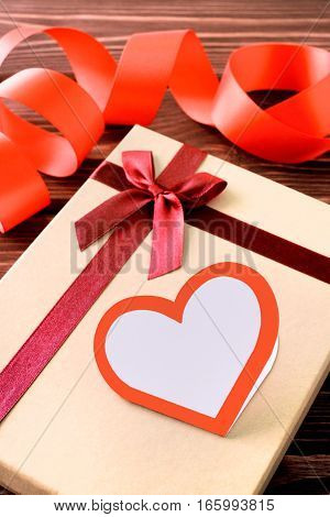 Gift for Valentine's day with a heart and ribbon