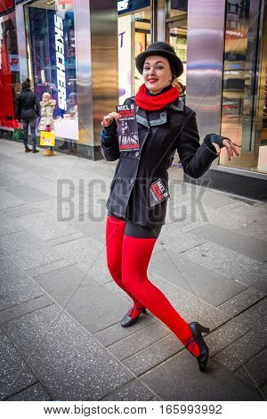 NEW YORK-JANUARY 20 - A young woman takes time out to pose as she hands out flyers for the play
