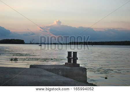 A berth on the sea cloudy background Jetty Dusk