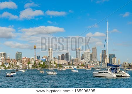 SYDNEY AUSTRALIA - OCTOBER 13 2016 : Panorama of Sydney waterfront and skyline with leisure boats moored in the bay.
